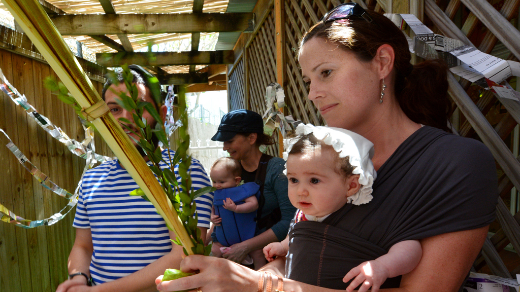 woman and baby lulav etrog sukkah cropped